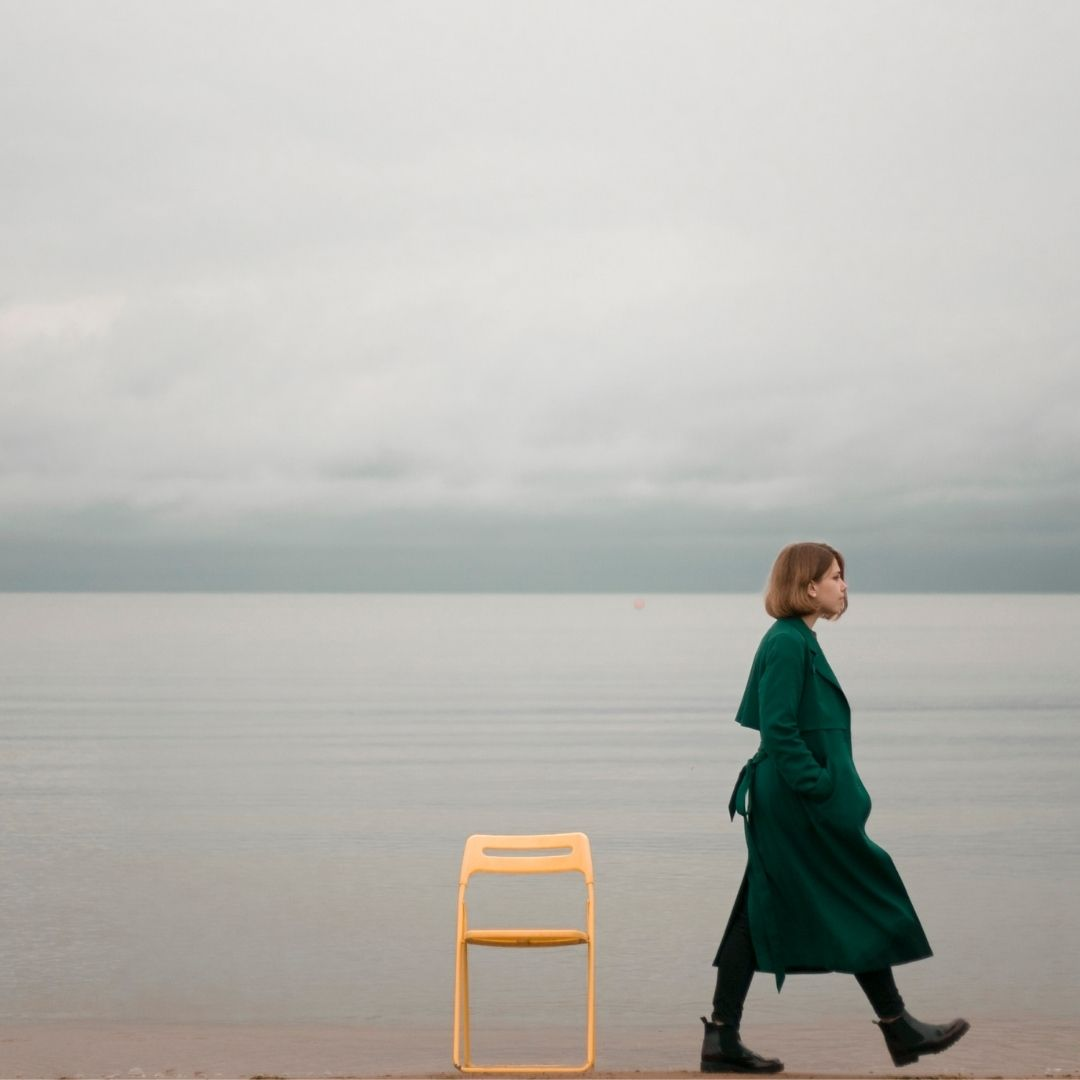 a woman alone with a brown chair
