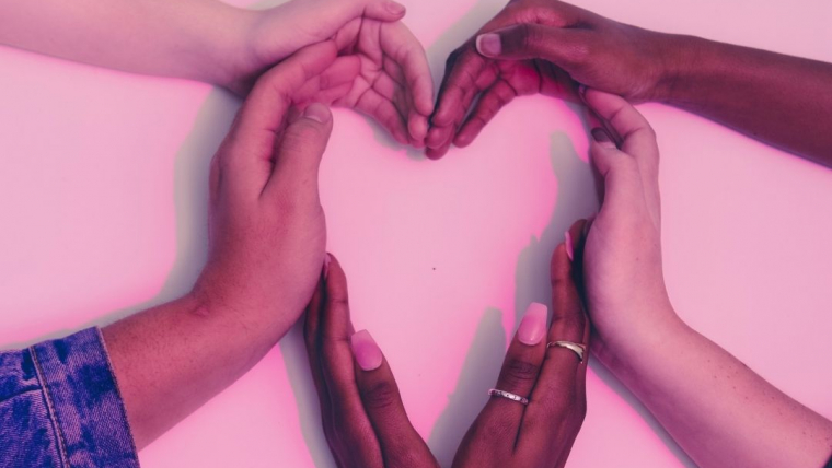 black and white hands in a heart