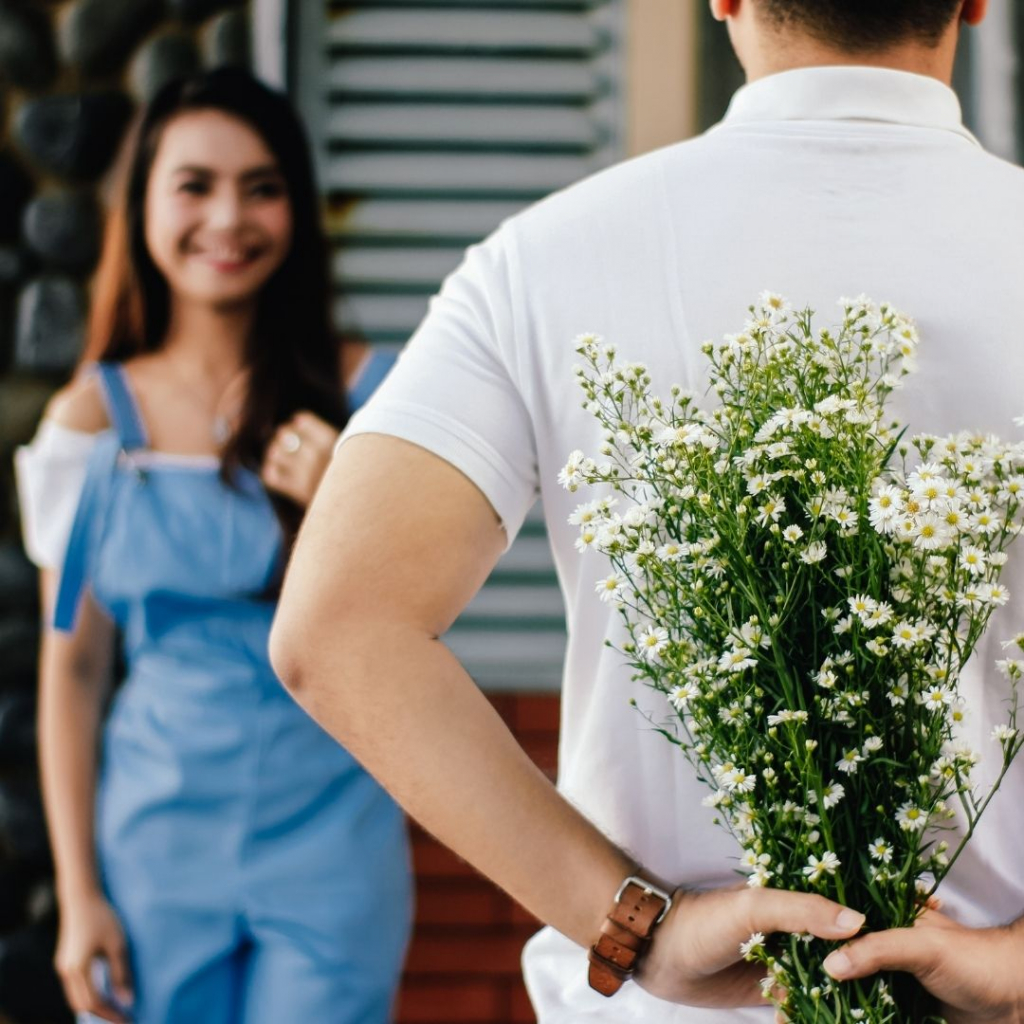 man bringing flowers to a girl